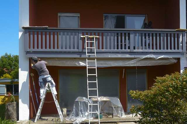 A Painter woking on ladders