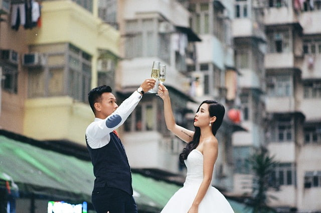 Wedding couple holding wine glass