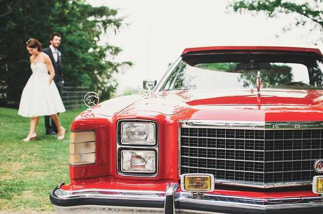 Wedding couple with Red limousine