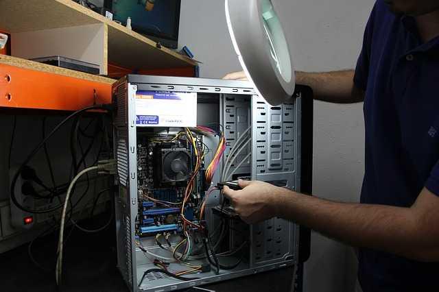 Computer Technician repairing a computer