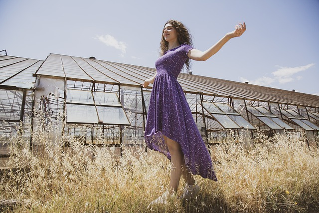 model in purple dress
